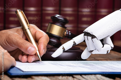 Obraz Robotic Hand Assisting Person For Signing Document - fototapety do salonu