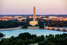 Washington DC. Washington Monument With Scaffolding And The Lincoln Memorial With The Potomac River And Bridges