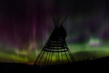 Aurora Borealis Over Tipi Display On Blackfeet Tribal Land Near St. Mary, Montana, USA