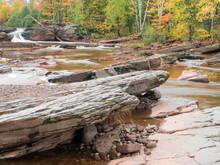 USA, Michigan, Upper Peninsula. Bonanza Falls, Where The Iron River Glides Over Smooth Slanted Rocks.