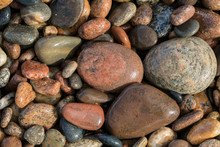 Smooth Granite Pebbles On Beach Of Lake Superior, Whitefish Point, Upper Peninsula, Michigan
