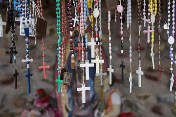 USA, New Mexico, Chimayo. Religious artifact left by believers at El Santuario de Chimayo, a church located between Santa Fe and Taos in New Mexico often called the Lourdes of America.