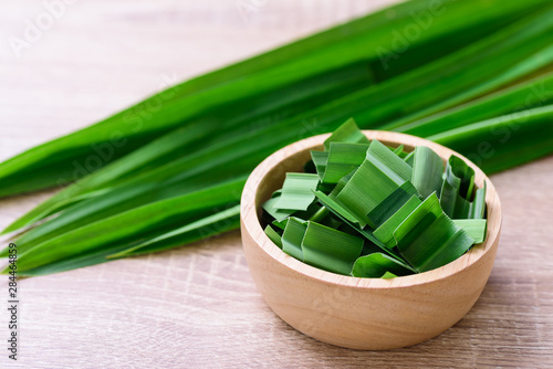 Fototapeta Sliced pandan leaf in a bowl, pandan leaf used to enhance the flavoring and color in Asia food and dessert obraz