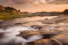 USA, Wyoming, Bridger National Forest, Bridger Wilderness, Wind River Range. Sunset On Rapids And Stream.
