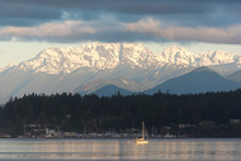 USA, Washington State, Puget Sound. Morning Light On Sailboat In Port Orchard Narrows. Snow-covered Olympic Mountains Beyond Kitsap Peninsula