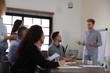 Portrait of volunteers having meeting in office