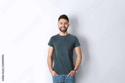 Pinturas sobre lienzo  Portrait of handsome smiling man isolated on white