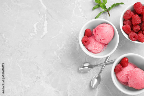 Fototapeta  Flat lay composition with delicious raspberry ice cream on grey marble table, sp