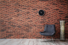 Grey Chair And Lamp Near Brick Wall. Modern Room Interior