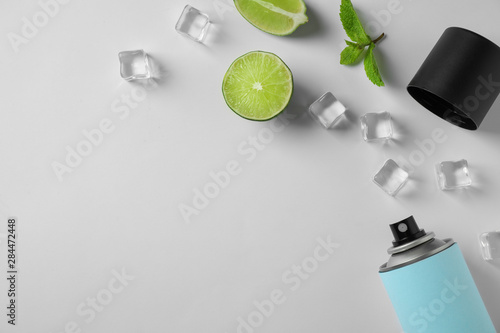 Photo Composition with spray deodorant on white background, top view