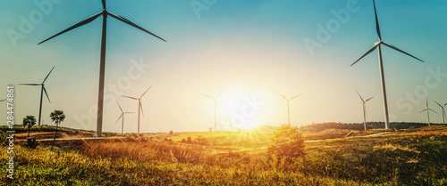 Fototapeta concept idea eco power energy in nature. wind turbine on hill and sunset obraz