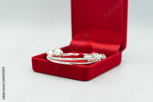 Gift baby is silver anklet in luxury red box. Wallpaper Mural