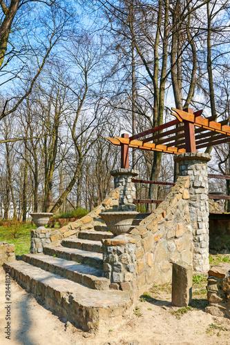 Fototapety, obrazy: Wooden gazebo in beautiful city park.