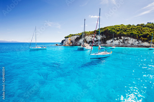 Beautiful bay with sailing boats yachts near the Paxos island, Greece