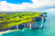 canvas print picture - Picturesque panoramic landscape on the cliffs of Etretat. Natural amazing cliffs. Etretat, Normandy, France, La Manche or English Channel. Coast of the Pays de Caux area in sunny summer day. France
