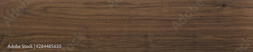 Fotografie, Tablou Black walnut wood texture of solid board oil finished