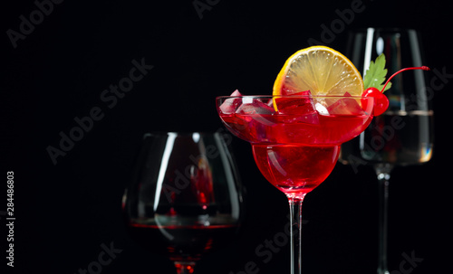 Fotografie, Obraz  Various alcoholic drinks on a black background.
