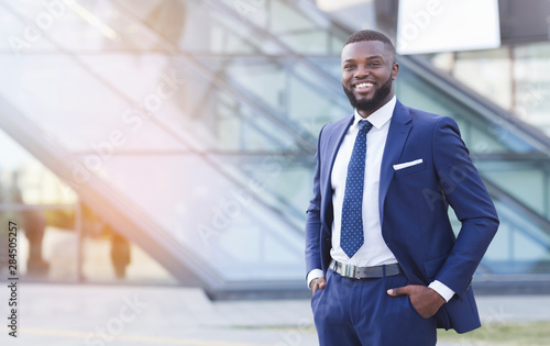 Friendly African American Businessman Standing And Smiling In Urban Area