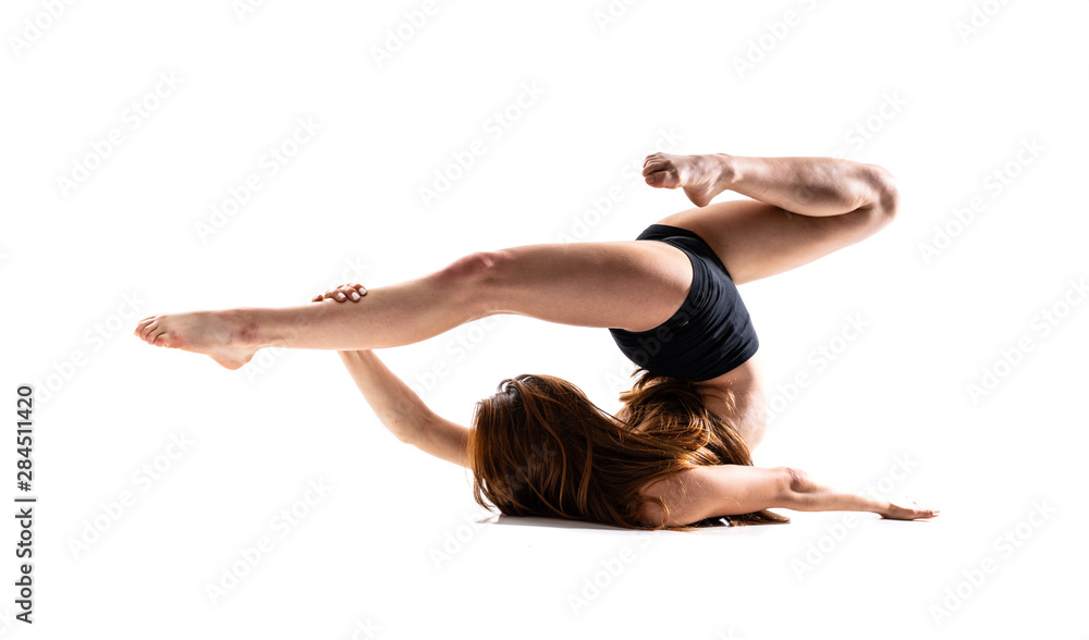 Fototapeta Young dance girl over isolated white background .