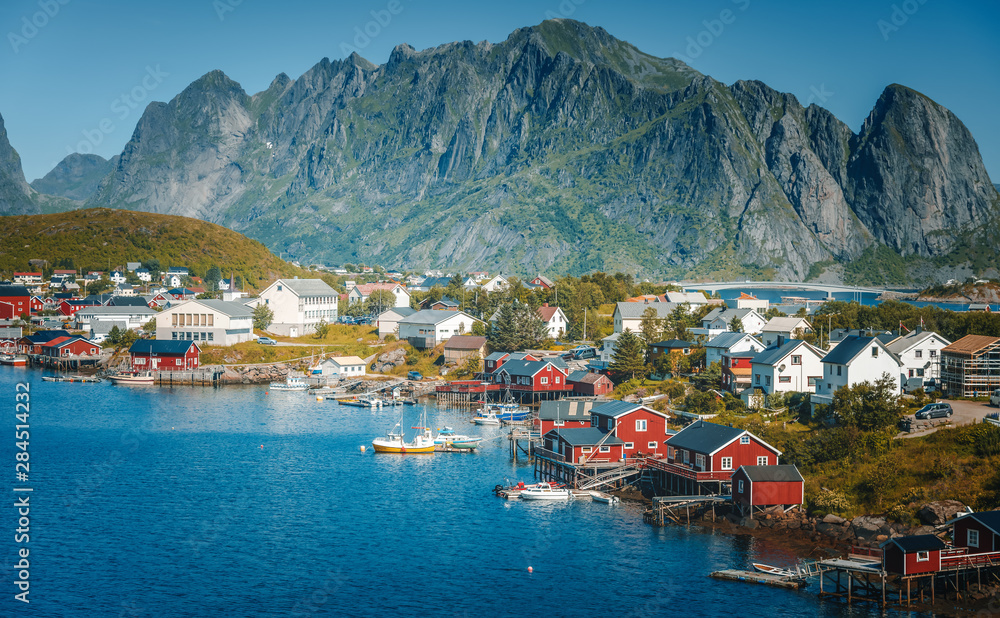 Fototapety, obrazy: View of the city of Reine on the Lofoten islands, a beautiful bright landscape, white and red houses on a background of rocks at sunset