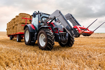 collecting straw bales after the harvest