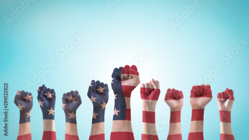 Labor day celebration concept with USA national flag on American people clenched Wallpaper Mural