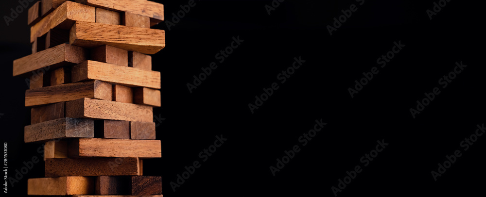 Fototapeta business organize  management strategy ideas concept wood stack block tower arranging with dark background