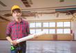 Engineering holding rolled blueprints in employment repair water leak drop interior office building under gypsum ceiling. blur background