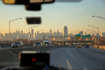 Beautiful view on the skyline of New York City as seen from the inside of a cab