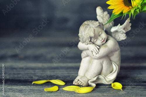 Guardian angel on wooden background - 284553290