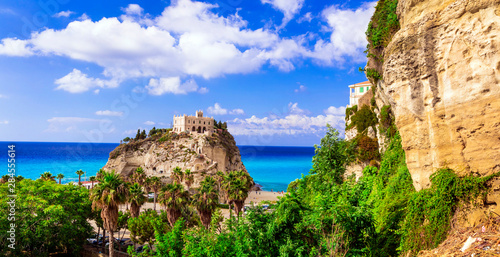 Landmarks of Calabria - iconic church in Tropea - Santa Maria del'isola on the rock over beautiful beach. Italy