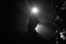 Silhouette Of A Working Miner ...