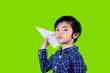 Leinwandbild Motiv Asian little boy playing a paper plane on studio