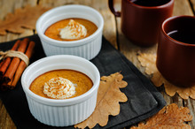 Baked Pumpkin Pudding With Whipped Cream And Cinnamon