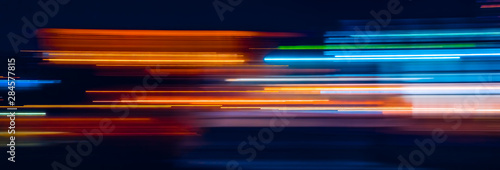 Fotomural Abstract Rainbow light trails on the dark background