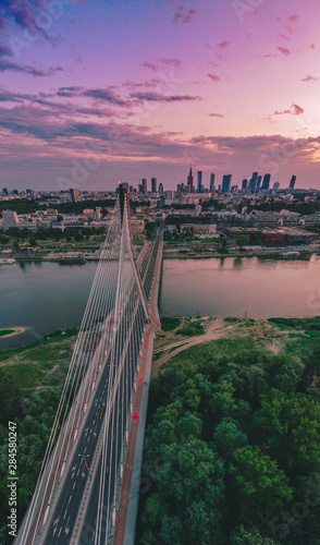 Fototapety, obrazy: Beautiful panoramic aerial short during the sunset . Open view to Warsaw city center from Swietokrzyski Bridge  . It's a cable-stayed bridge  in Vistula river Warsaw, Poland