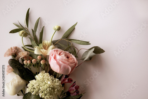 Horizontal image of fresh cut, pastel flowers and greenery on a white background Fototapete