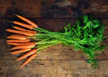 Freshly Picked Organic Carrots On A Rustic Wooden Table Top, Home Grown, Plant Based, Above View,