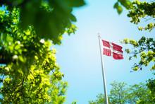 Denmark Flag, Danish Flag Waving In The Wind Between Trees