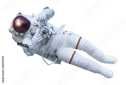Leinwand Poster The astronaut, with the device in hands, in a space suit, isolated on a white background