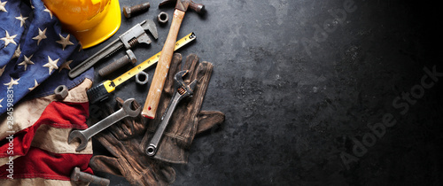 Construction and manufacturing tools with patriotic US, USA, American flag on dark black background - 284598831