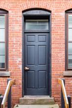 Black Door Old Brick Building