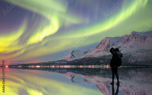 Photo sur Aluminium Olive Northern lights (Aurora borealis) in the sky over Tromso, Norway