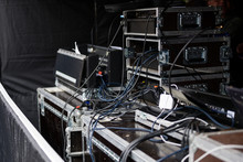 Cases And Racks From A Sound Amplification System For An Event On An Open-air Stage