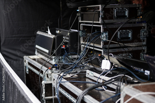 Photo cases and racks from a sound amplification system for an event on an open-air st