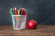 Back to school concept. Pencils and apple on table