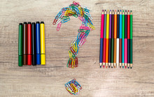 Choice Concept - Colored Pencils Or Felt Pens Isolated On Wooden Background