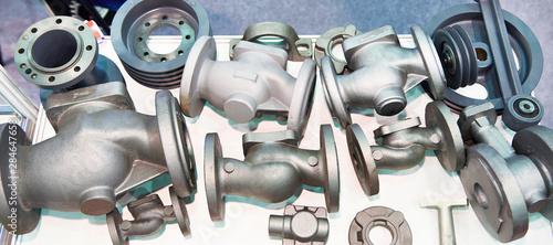 Fototapeta Cast iron parts for industrial valves obraz