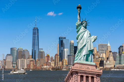 Fototapeta The Statue of Liberty over the Scene of New york cityscape river side which location is lower manhattan,Architecture and building with tourist concept obraz