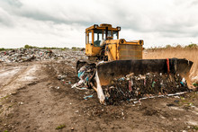 Bulldozer On Garbage Dump